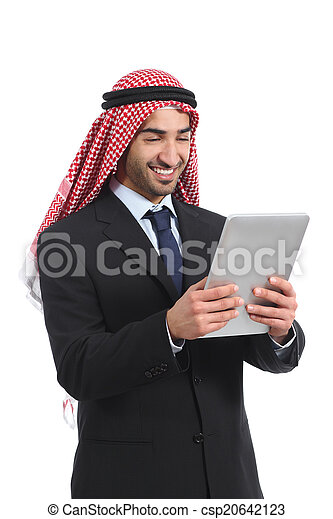 Arab saudi businessman reading a tablet reader - csp20642123