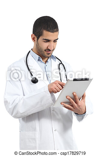 Arab saudi doctor man reading a tablet reader - csp17829719
