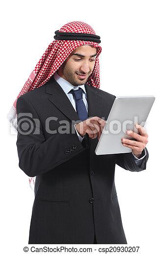 Arab saudi emirates businessman working with a tablet reader - csp20930207