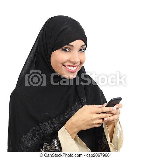 Arab saudi emirates smiling woman using a smart phone - csp20679661