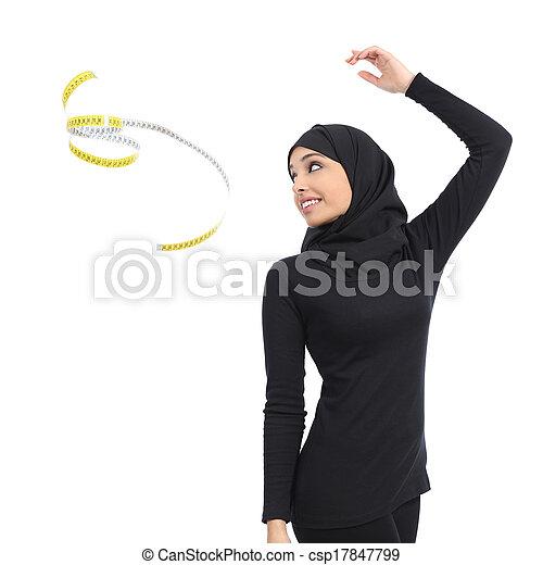 Arab saudi fitness woman throwing a measure tape - csp17847799