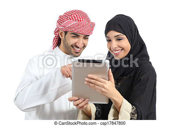 Arab saudi happy couple browsing a tablet reader - csp17847800