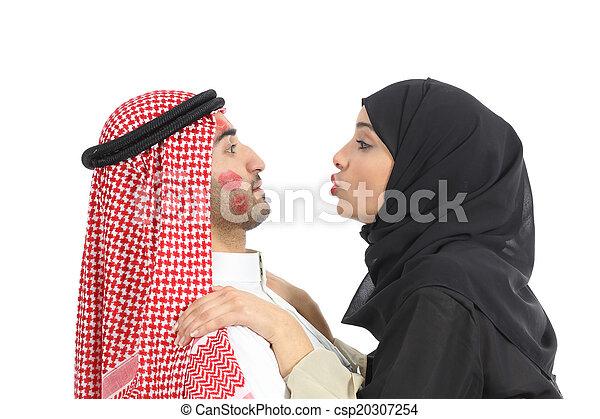 Arab saudi obsessed woman kissing a man - csp20307254