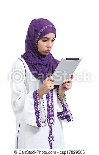 Arab woman bored reading a tablet reader - csp17829505
