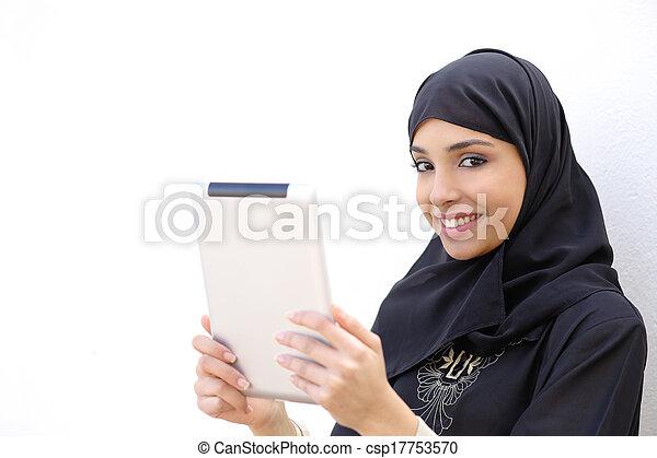 Arab woman holding a tablet and looking at camera - csp17753570