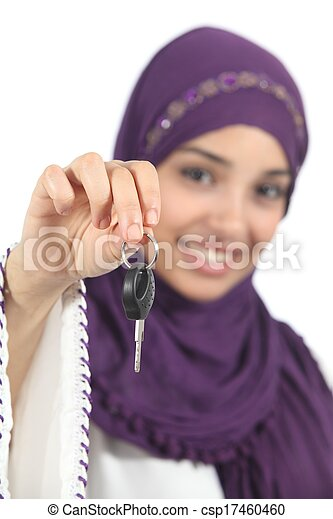 Arab woman holding and showing a car key - csp17460460