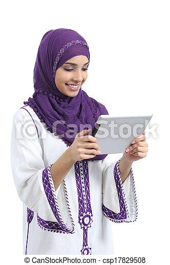 Arab woman reading a tablet reader - csp17829508