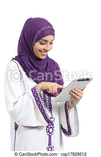 Arab woman reading and touching a tablet reader - csp17829512