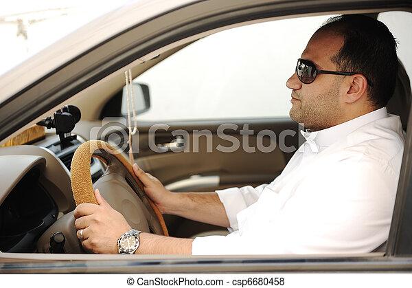 Arabic man driving a car - csp6680458