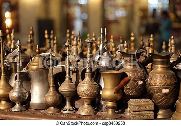 Arabic souvenirs for sale in Souq Waqif, Doha Qatar - csp8450258