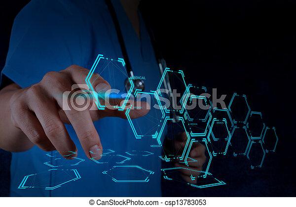 Mediziner Handarbeit mit moderner Computerschnittstelle - csp13783053