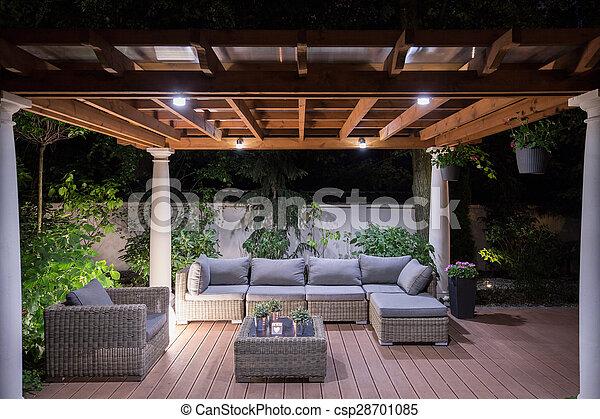 Arbour with comfortable garden furniture - csp28701085