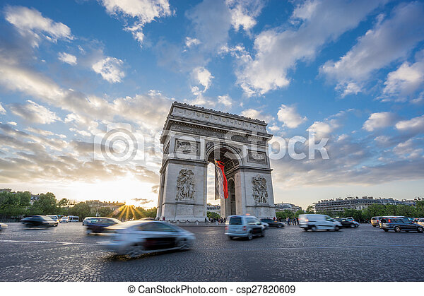 Arc de Triomphe and blurred traffic at sunset - csp27820609