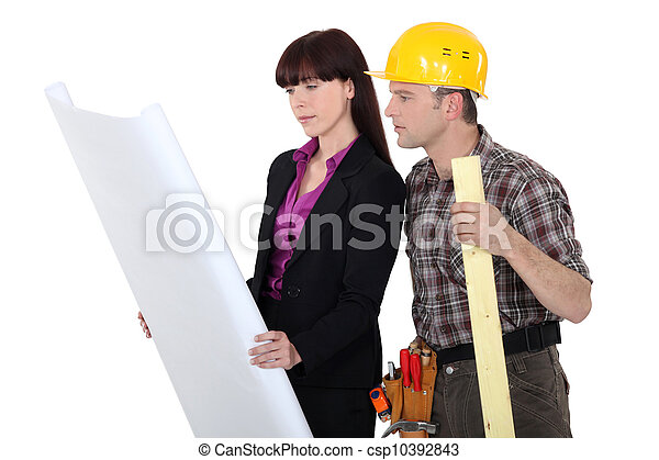 Architect and a carpenter looking at plans - csp10392843