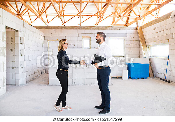 Architect and civil engineer at the construction site. - csp51547299