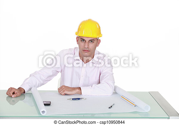 Architect drawing plans at his desk - csp10950844