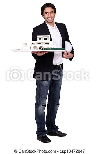 architect holding a helmet and a model of a house - csp10472047