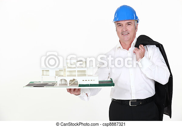architect holding a miniature model of a house - csp8887321