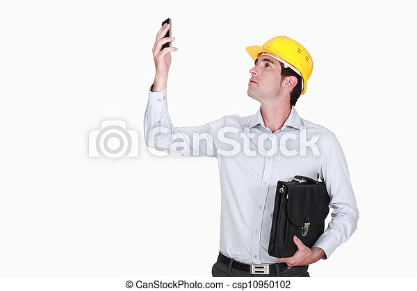 Architect holding briefcase and mobile telephone - csp10950102