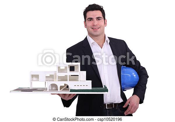 Architect holding replica model of building - csp10520196