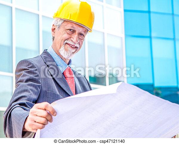 Architect Looking At Blueprint - csp47121140