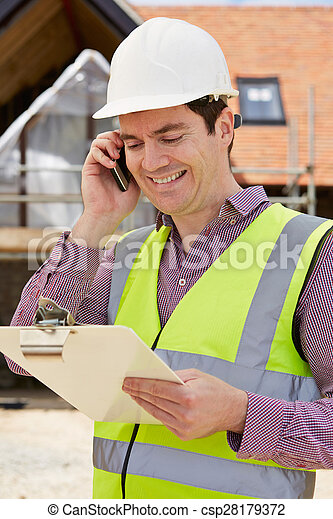 Architect On Building Site Using Mobile Phone - csp28179372