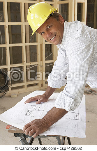 Architect Studying Plans In New Home - csp7429562