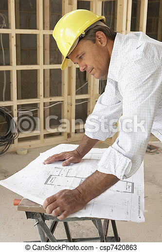 Architect Studying Plans In New Home - csp7420863