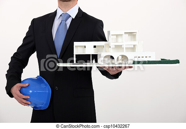 Architect with a model of a commercial development - csp10432267