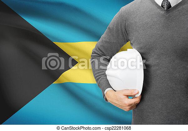 Architect with flag on background - Bahamas - csp22281068