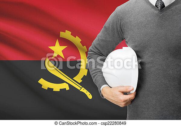 Architect with flag on background - Angola - csp22280849