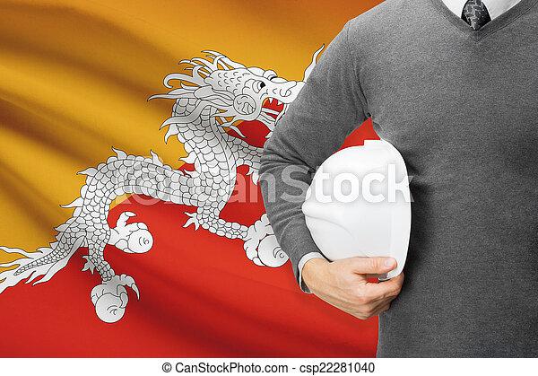 Architect with flag on background - Bhutan - csp22281040