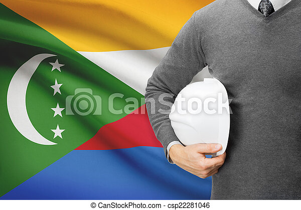 Architect with flag on background - Comoros - csp22281046