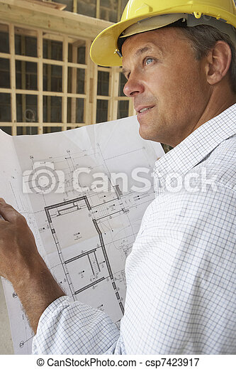 Architect With Plans In New Home - csp7423917