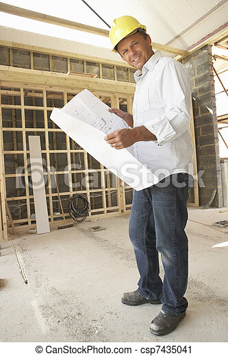 Architect With Plans In New Home - csp7435041
