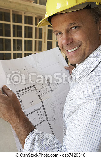 Architect With Plans In New Home - csp7420516