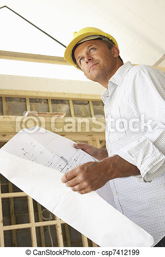 Architect With Plans In New Home - csp7412199