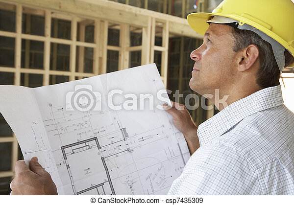 Architect With Plans In New Home - csp7435309