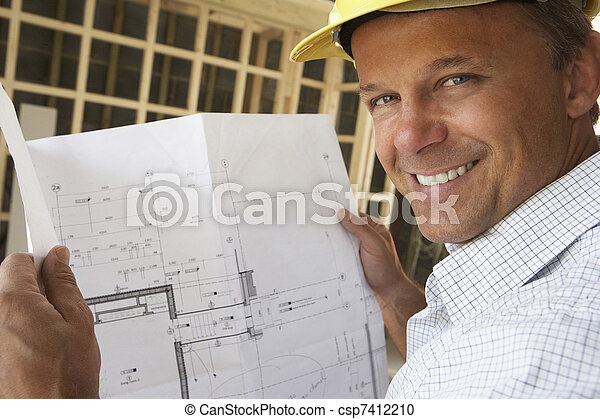 Architect With Plans In New Home - csp7412210