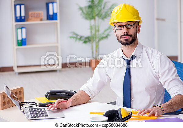 Architect working in his studio on new project - csp58034688