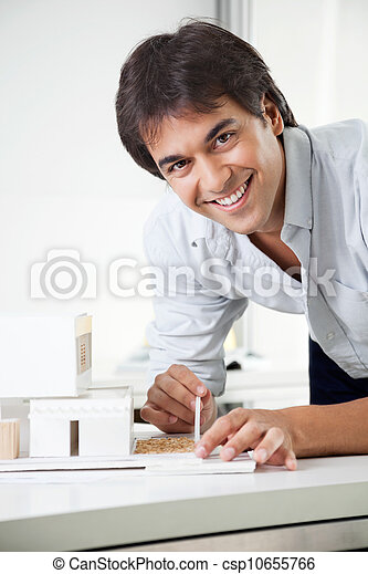 Architect Working On a Model House - csp10655766