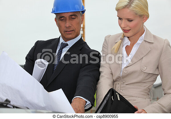 Architects discussing plans on site - csp8900955