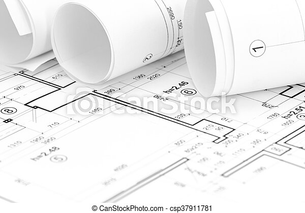 Architectural Background With Floor Plan And Rolls Of Blueprints