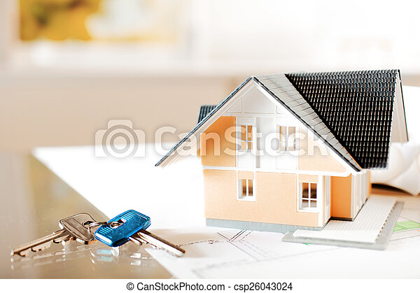 Architectural Miniature Home on Blueprint with Key - csp26043024