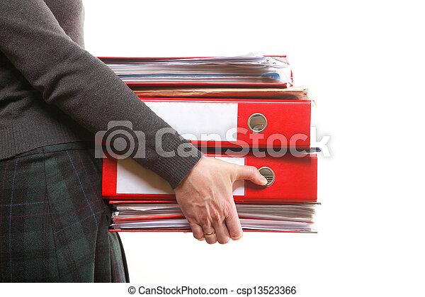 Una empleada de oficina con una pila de archivos - csp13523366