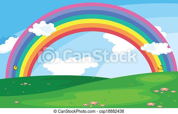 Un paisaje verde con un arco iris en el cielo - csp18882438