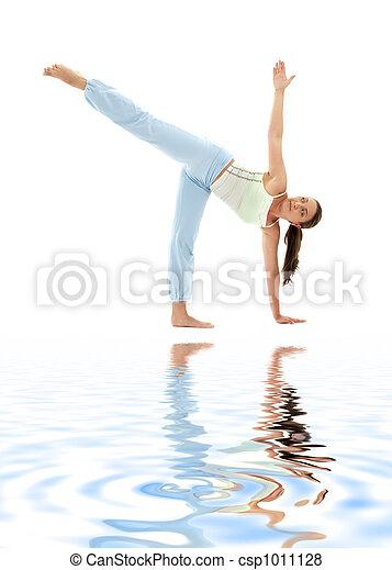 sporty girl practicing ardha chandrasana half moon pose on