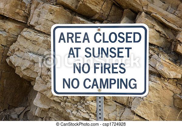 area closed at sunset - warning sign - csp1724928