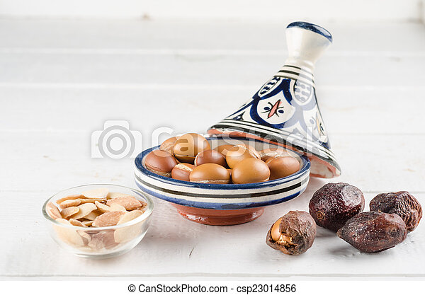 Argan fruit in a moroccan tajine - csp23014856