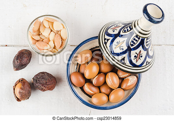 Argan fruit in a moroccan tajine - csp23014859